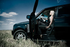 Blonde in car salon Royalty Free Stock Images