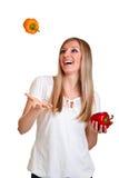 Blonde caucasiam Frauen-Holdingfrucht Stockbilder