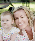 Blonde caucasian mother with baby girl Stock Photography