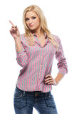 Blonde caucasian woman pointing at copyspace Stock Images