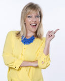 Blonde Caucasian Woman Smiling and Pointing Stock Photography