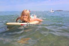 Girl bodyboarding royalty free stock images