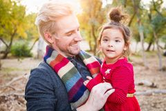 Blonde Caucasian Young Man with Mixed Race Baby Girl Outdoors. Handsome Caucasian Young Man with Mixed Race Baby Girl Outdoors stock photos