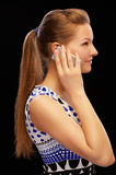 Blonde with cellphone Royalty Free Stock Image