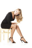 Blonde on chair Stock Photos