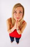 Blonde che osserva in su e che prega Fotografia Stock Libera da Diritti