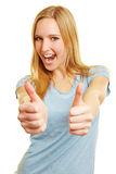 Blonde cheering woman holding both thumbs up. Blonde cheering happy woman holding both thumbs up Royalty Free Stock Images