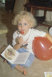 A blonde child eating a lollipop at a daycare center, Washington D.C. Stock Photography