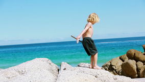 Blonde child holding a wooden stick stock footage