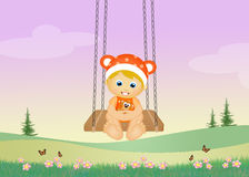 Blonde child on swing Stock Image