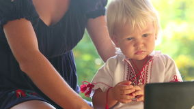 Blonde Child in Vyshyvanka Watching Cartoon stock video footage