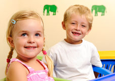 Blonde children are happy Royalty Free Stock Photo