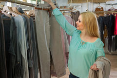 Blonde choosing new clothing Stock Image