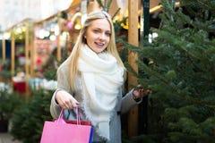 Blonde at Christmas Fair Royalty Free Stock Image