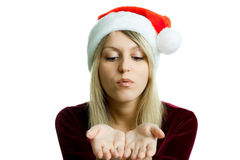 Blonde in a Christmas hat on the isolate Royalty Free Stock Photos