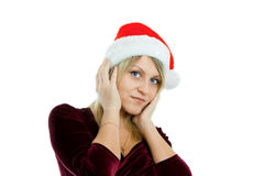 Blonde in Christmas hats Stock Images