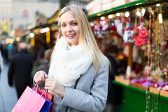 Blonde at Christmas marketplace Stock Images
