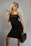 Blonde with cigar and valise Royalty Free Stock Photos