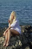 Blonde with a cigarette near sea Stock Photo