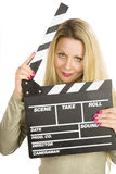 Blonde with clapperboard stock photo
