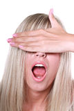 Blonde closing her eyes with a hand Stock Images
