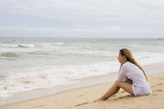 Blonde at coastline Stock Photography