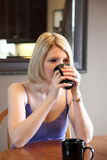 Blonde with coffee Royalty Free Stock Photography