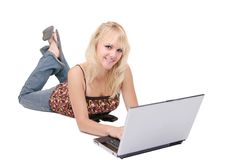 Blonde college girl studying. One blonde attractive college student girl studying with laptop over white stock image