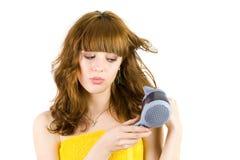 Blonde com secador de cabelo fotografia de stock royalty free