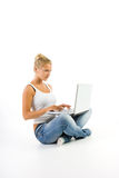 Blonde and computer Royalty Free Stock Image