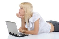 Blonde with a computer Royalty Free Stock Photo