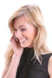 Blonde con el móvil Imágenes de archivo libres de regalías