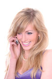 Blonde con el móvil Imagen de archivo libre de regalías