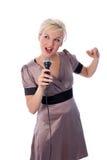 Blonde con el mic fotos de archivo libres de regalías