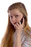 Blonde con el teléfono celular Foto de archivo libre de regalías
