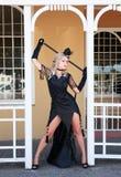 Blonde con el vestido negro Fotos de archivo libres de regalías