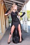 Blonde con el vestido negro Imagen de archivo libre de regalías