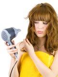 Blonde con l'asciugacapelli Fotografia Stock Libera da Diritti