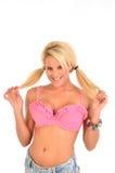 Blonde con le code del maiale Immagine Stock