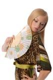 Blonde con un ventilador de la mano Fotos de archivo libres de regalías