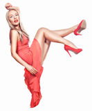 Blonde in a coral dress. Royalty Free Stock Images