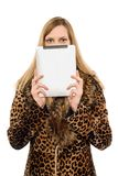 Blonde covers face. Pretty blonde covers face with the tablet pc stock photography