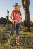 Blonde Cowgirl. A blonde model posing as a cowgirl in a western environment Stock Photography