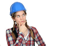 Blonde craftswoman. A blonde craftswoman looking puzzled Royalty Free Stock Images