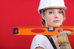 Blonde craftswoman holding ruler Stock Photo