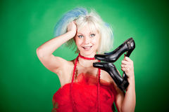 Blonde crazy girl holding shoes Royalty Free Stock Photography