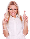 Blonde with crossed fingers Royalty Free Stock Images