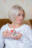Blonde with a cup Royalty Free Stock Image