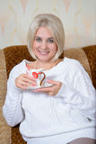 Blonde with a cup Royalty Free Stock Photo