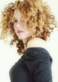 Blonde Curls. Soft focus on young woman with blonde curls stock photography